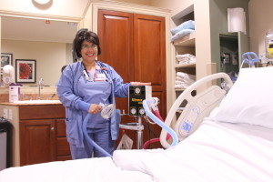 Nurse standing by hospital bed
