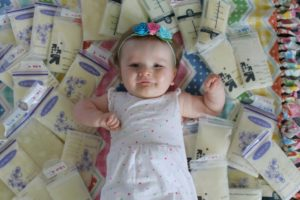 baby girl with breastmilk