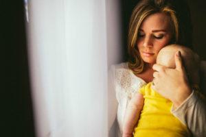 Woman with baby near window