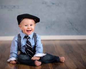 little boy wearing hat