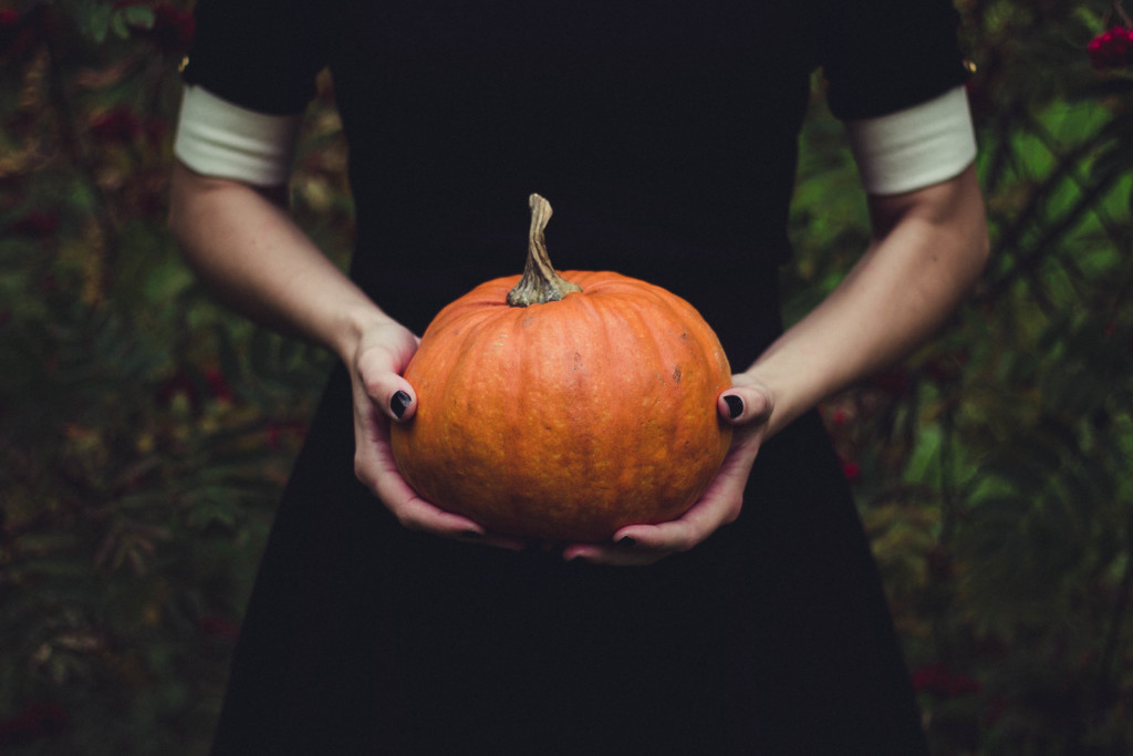 person holding pumpkin
