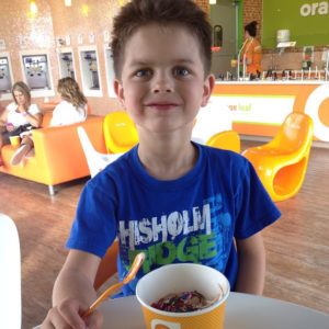 boy eating fro yo