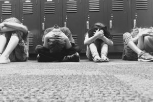 Kids crouching at school
