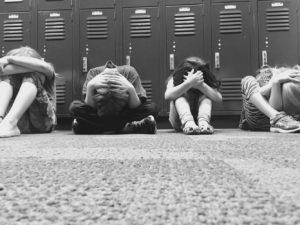 Kids crouching at school