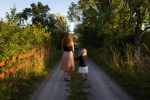 mother daughter walking down path