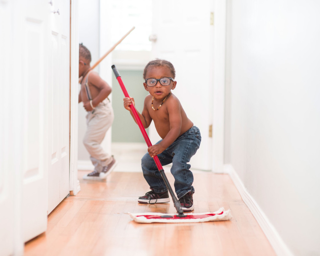 boys mopping floor for chores