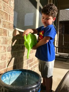 boy with a watering can