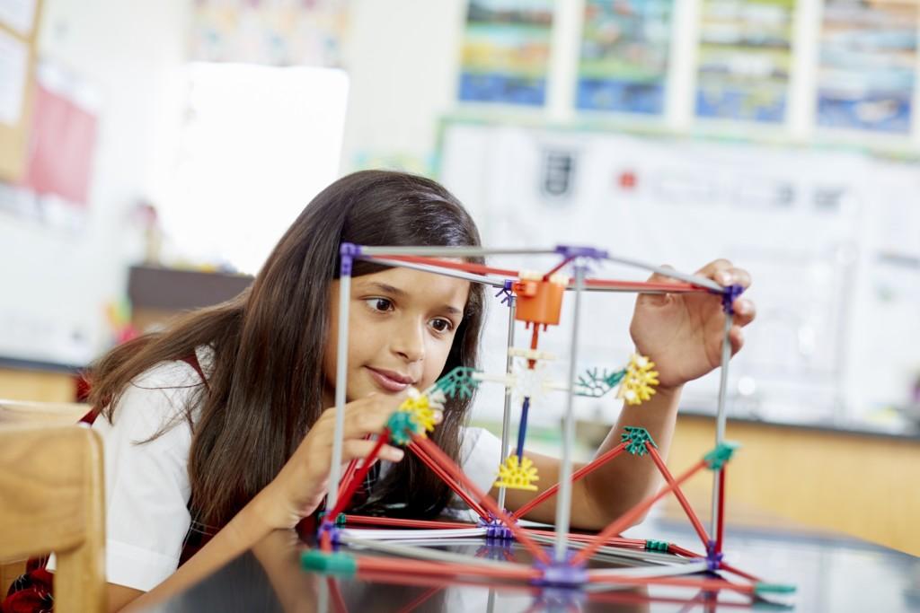 Girl Building Cube - Hill School