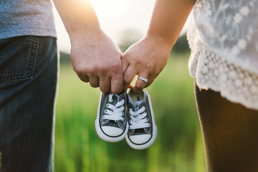 baby shoes parents hands