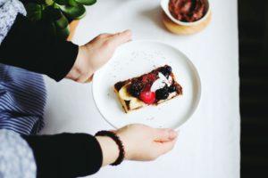 woman serving fruit tart