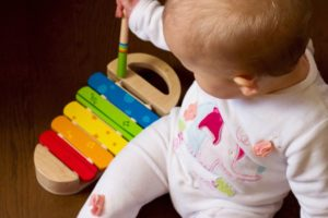 baby with instrument
