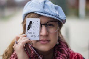 woman sign dare to dream