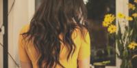 wavy hair yellow shirt