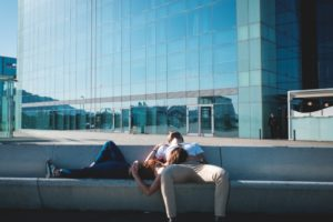 couple sleeping in city