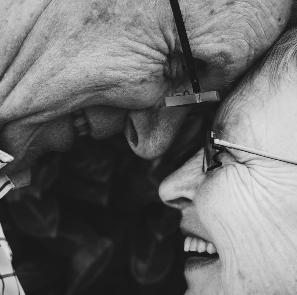 older couple laugh smile