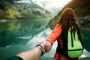 couple hiking at lake