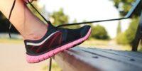 Woman Tying Running Shoe