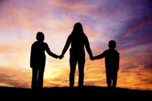 mom holding kids hands