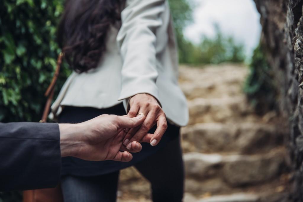 wife leading husband hands