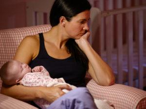 emotional mother holding infant