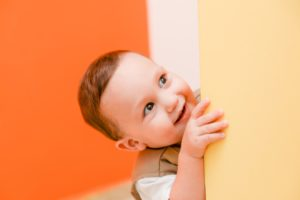 toddler peeking around corner