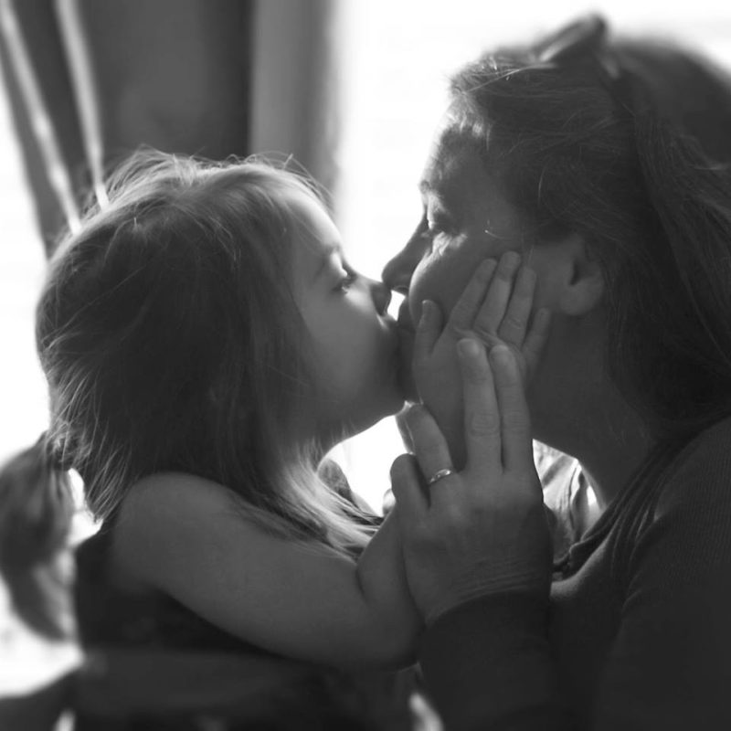 child grandmother kiss