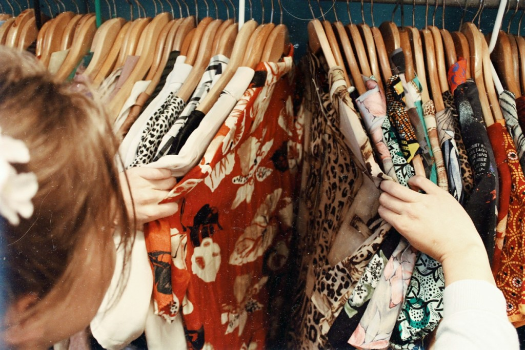 woman shopping clothing rack