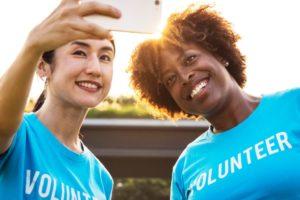 women volunteer selfie