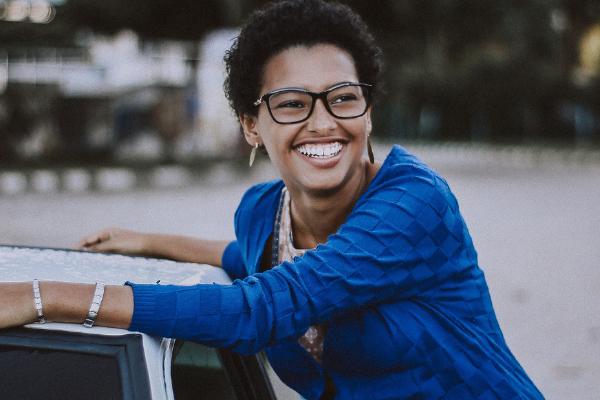 woman smiling by car horizontal