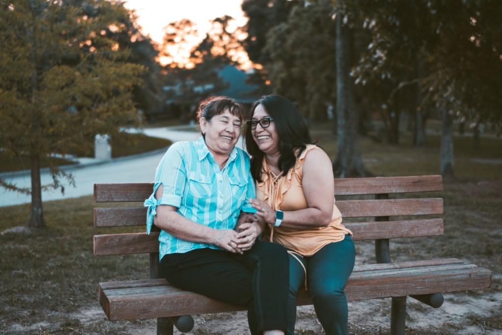 women talking laugh generational