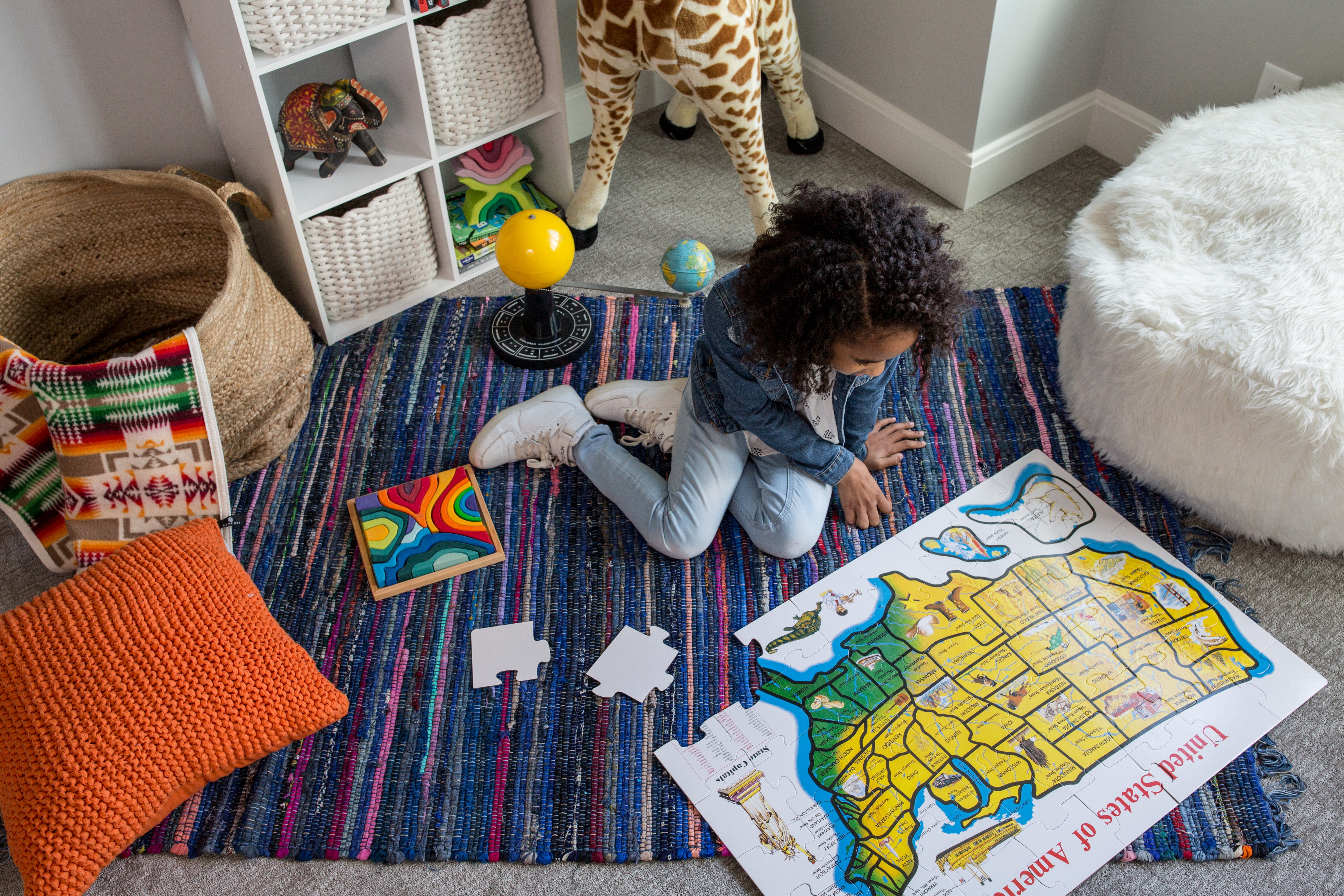 child plays alone with puzzle