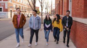 teenagers walking down street