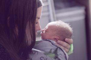 mother nuzzling newborn nose