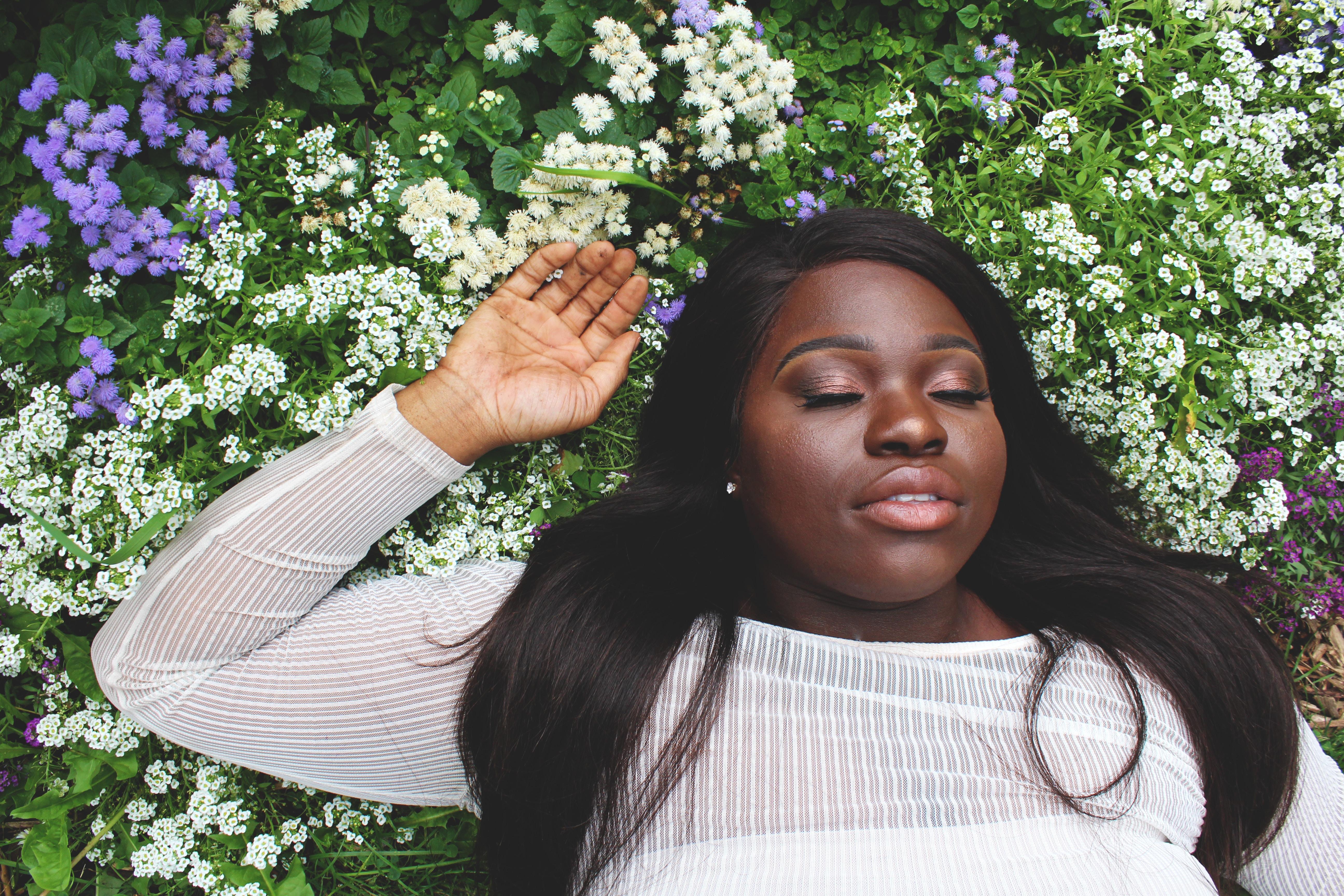 woman sleeping in flowers