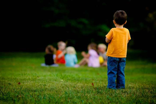 boy not socializing with friends