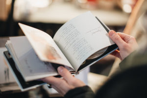 flipping through pages of a book