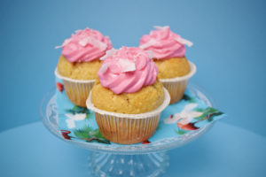 Canva - Three Cupcake With Pink Icing