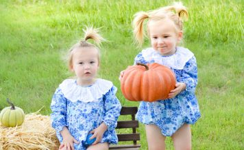 twins carrying pumpkins