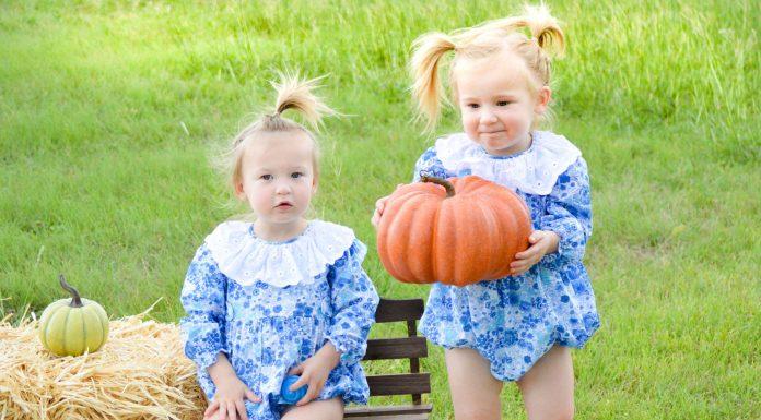 twins carrying pumpkins