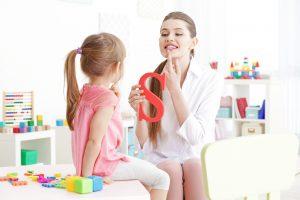 speech therapist teaching toddler