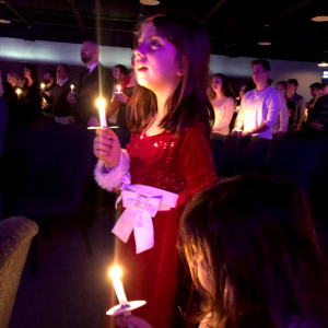 Go to a candlelight church service on Christmas Eve to make a tradition.