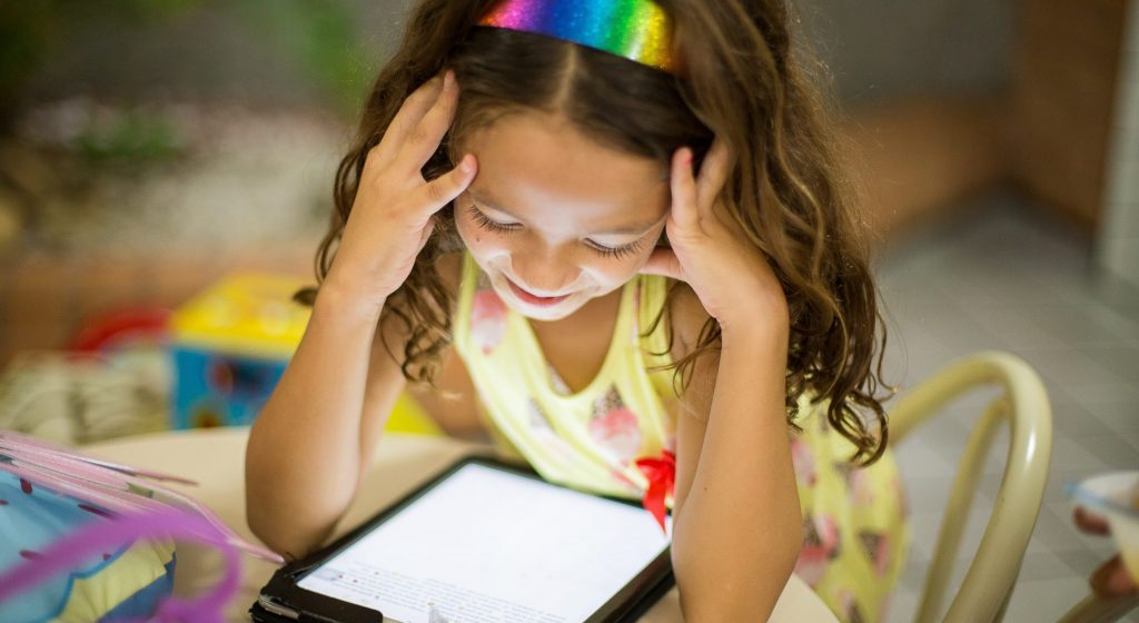 Using technology is an easy, fun way to entertain kids when traveling.
