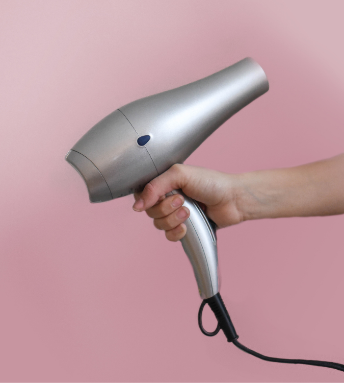 Use a hair dryer to style long hair.