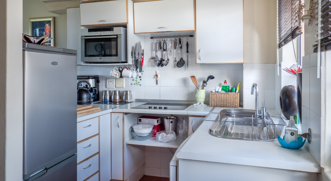 Wiping the counters and doing dishes keeps things tidy.