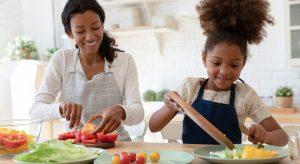 Let kids help prepare food to encourage nutritious eating habits.