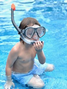 Our autistic son got lots of practice time in the pool during our vacation.