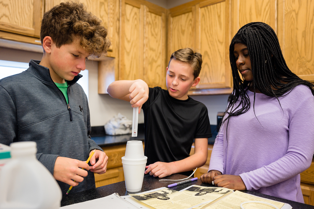 Students work together at Montessori School of Fort Worth.