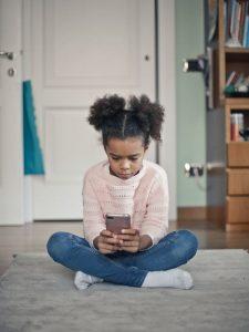 little girl on cell phone