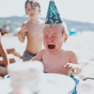 Crying over birthday cake